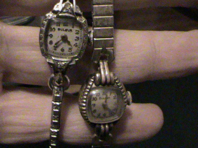 searched for hours cannot find the model/value of these. both 17 jewel. both watches tick and are 4 sale. the one on the left has 2 stones (diamonds?) and is stamped 10 gold filled L0...1950 on the case and on the 5AF movement. the one on the right is stamped L1 on the case which gives it a 1951 date. however, on the 6AH movement it has the * asterisk stamp dating it to 1941. any help on the value of these would be apprieciated. thanks