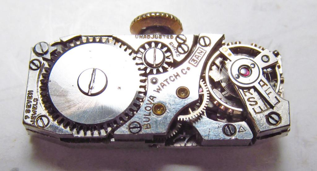 Movement 3AN, triangle pictomark date code for 1935, 7 jewels.