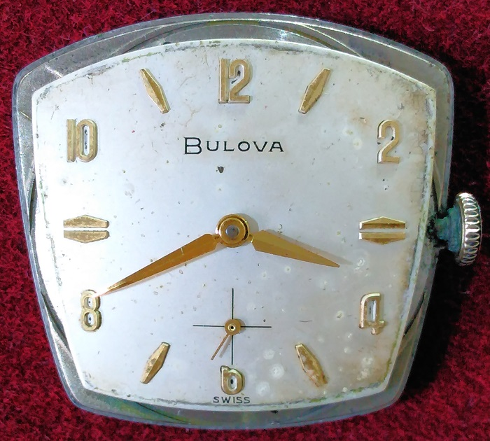 Bare dial with pitting