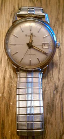 Bulova 1965 stainless, white dial, date window, crosshairs, gold hands, seconds