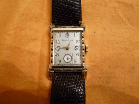 Bulova watch with diamond dial and fancy case