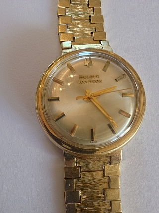 Bulova 18K gold watch