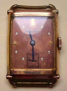 1945 rose gold Bulova tank watch